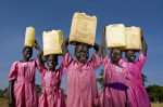 Schoolgirls carry water in Katine village 2009 giclee art print