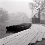 Boats lined up at a lake in an english park giclee art print